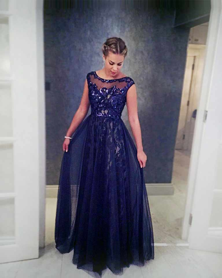 Blue ball gown worn at Russian Ball, London. Tulle bodice with boat neck and sequins.