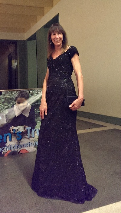 Margaret wears our long off shoulder evening dress to her Children's Trust Ball