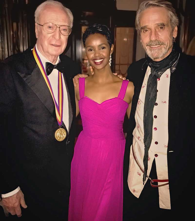 Ilwad Elman in beautiful fitted fuschia evening dress, with Sir Michael Caine & Jeremy Irons at the Academy of Achievement Summit Awards